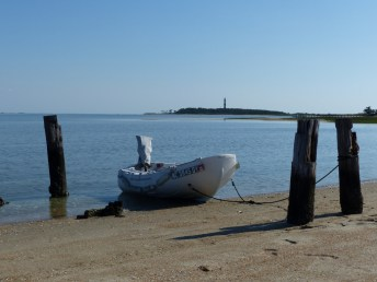 dinghy, lighthouse beyond