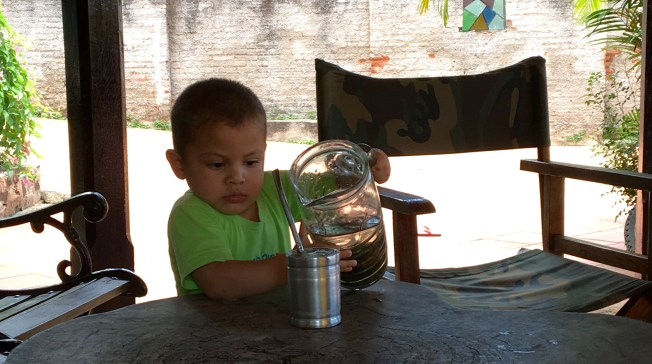 Boy pouring terere_cropped