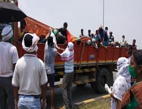 (Ration help to migrants at NH 10)