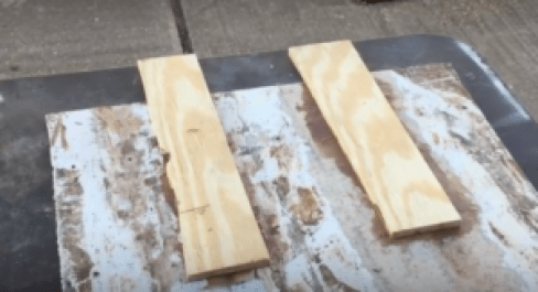 2 Peices of wood adhered to test glass