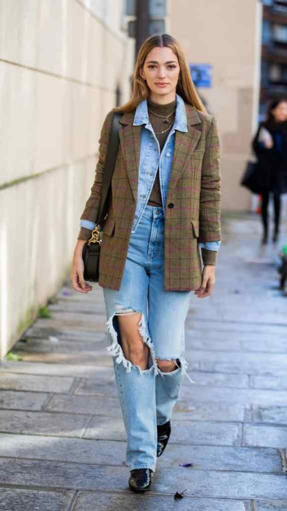 lady wearing denim jacket under another another jacket