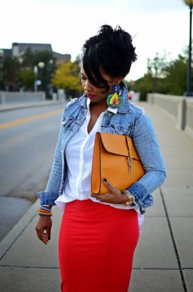 lady wearing denim jacket on red skirt