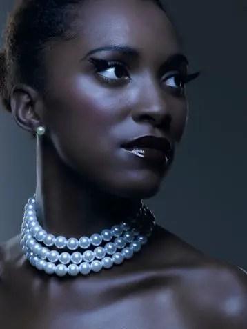 beautiful woman wearing pearl bead necklace
