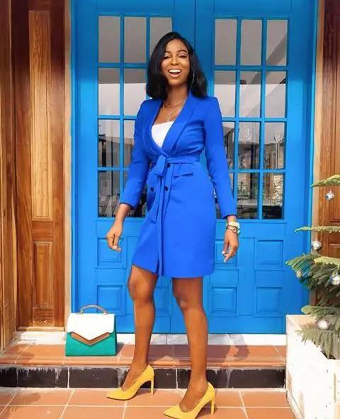 Ola Adewale in a blue dress