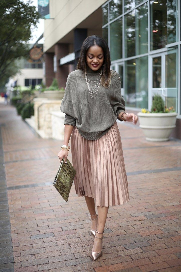 lady in a loose top - Outfits for Ladies with Big Belly