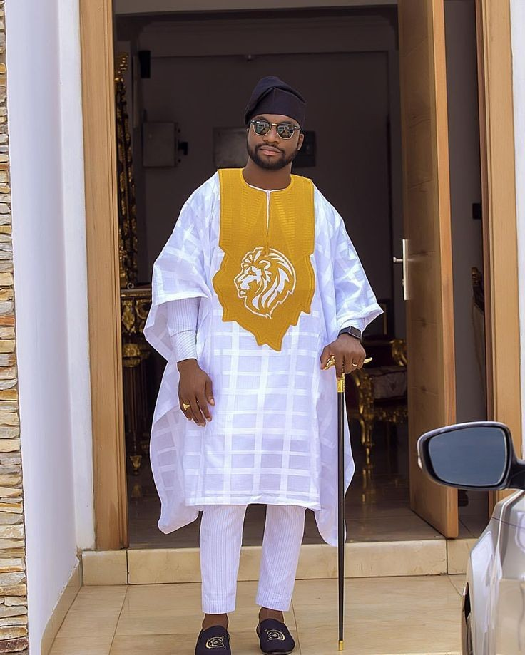 man in white embroided agbada