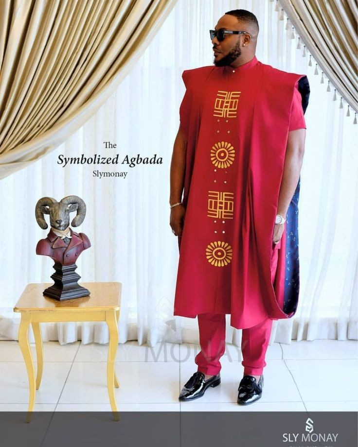 man wearing red agbada and sunglasses