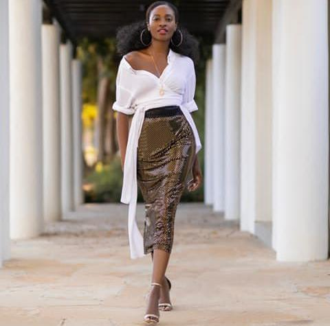 white top on dark midi skirt.