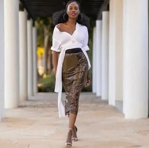 white top on dark midi skirt.