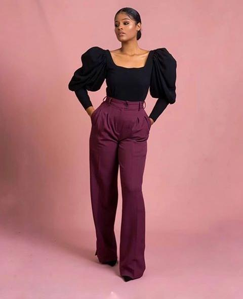 a woman in a simple work-wear attire