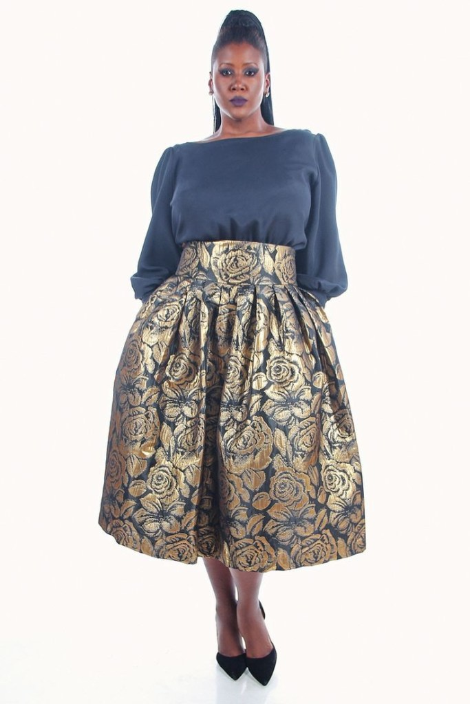 African lady in an animal print flare skirt