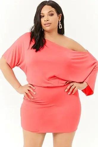 a plus-size lady in a pink blouson dress
