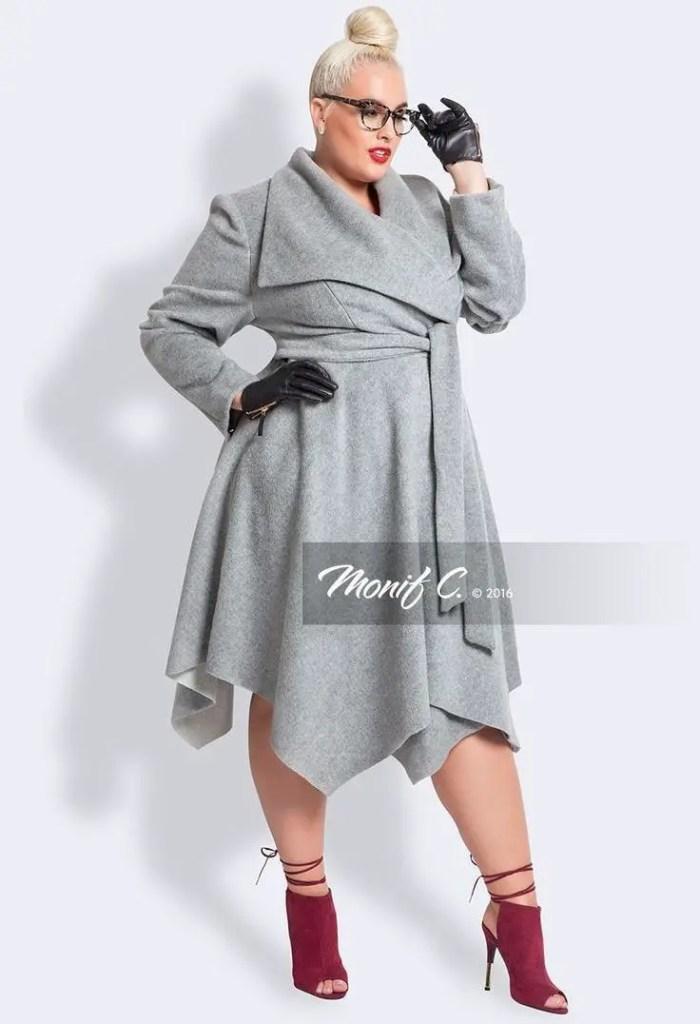 a white lady in asymmetrical dress