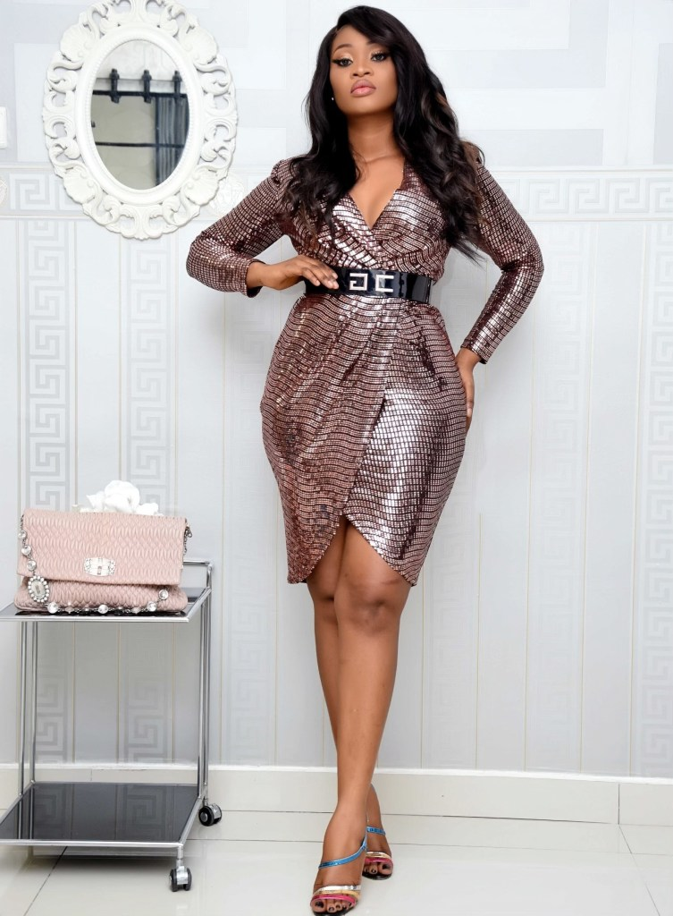 curvy lady in a sequin wrap dress