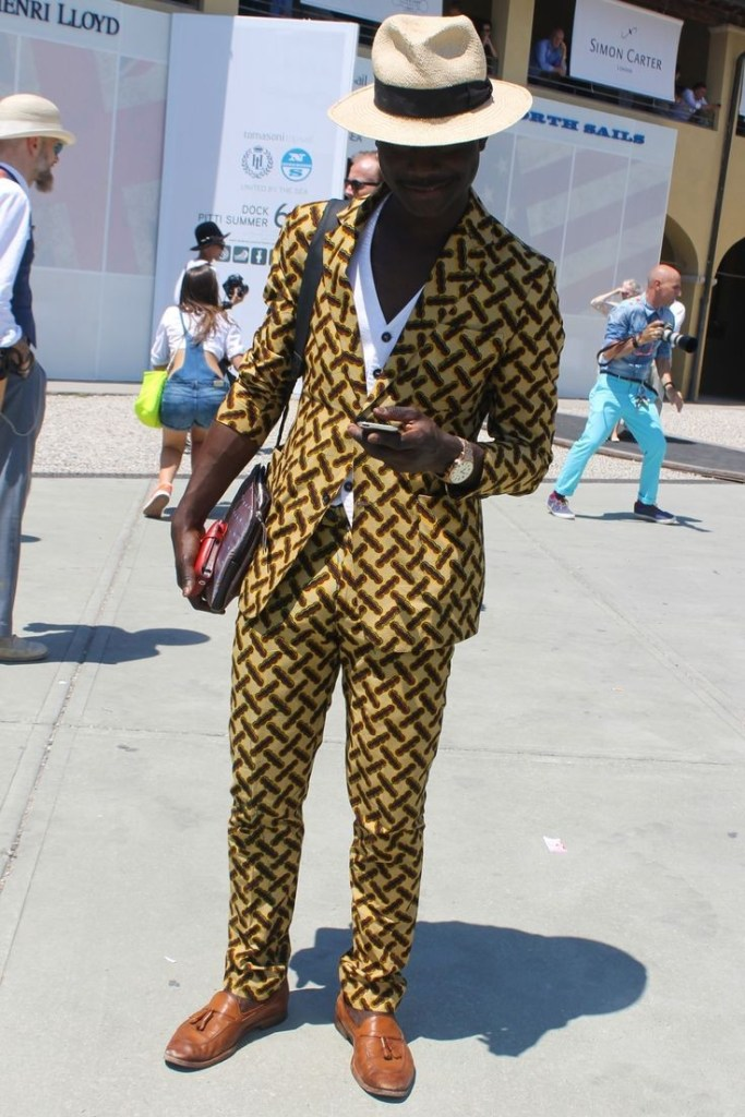 man in ankara suit and hat