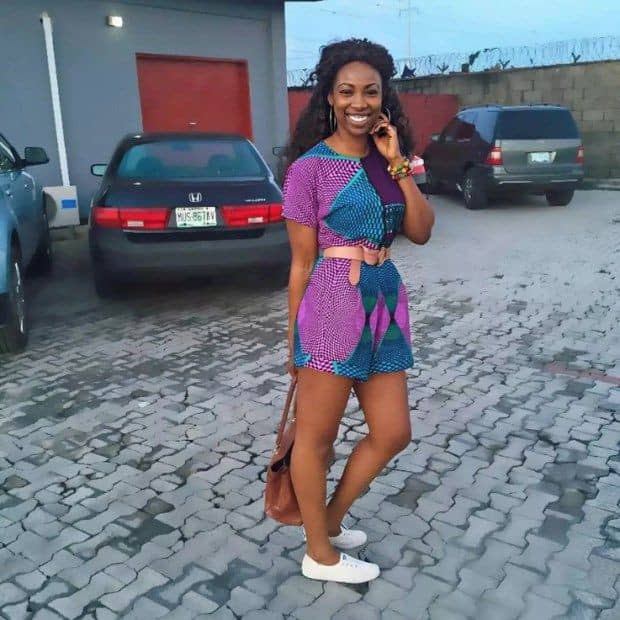 lady in ankara playsuit and sneakers