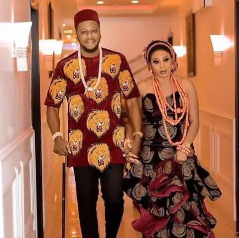 a couple in isi agu attire