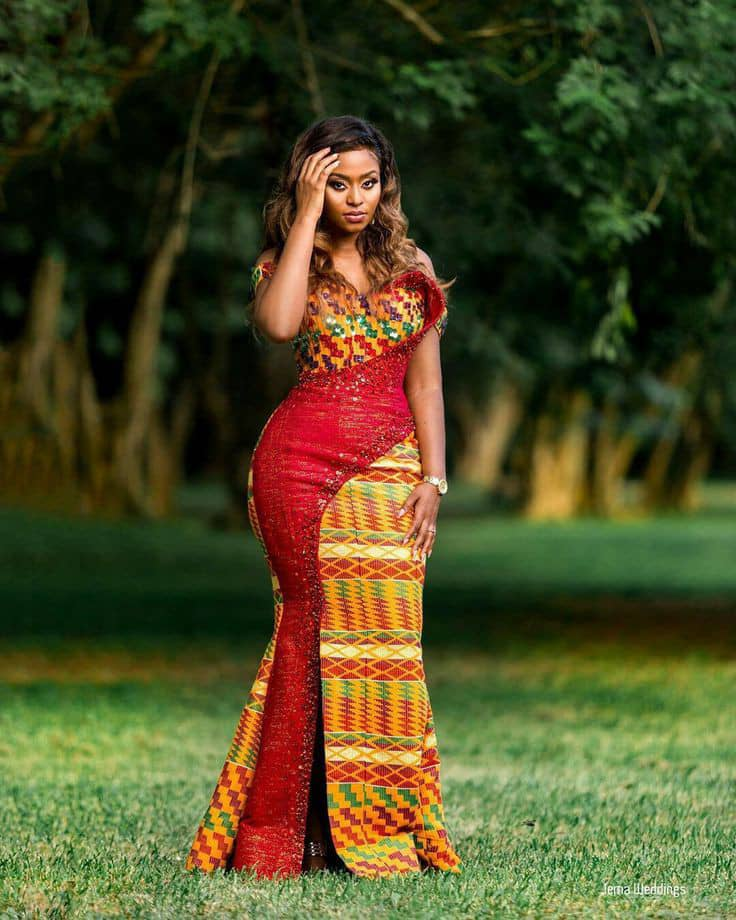 Lady in kente dress mixed with other fabric