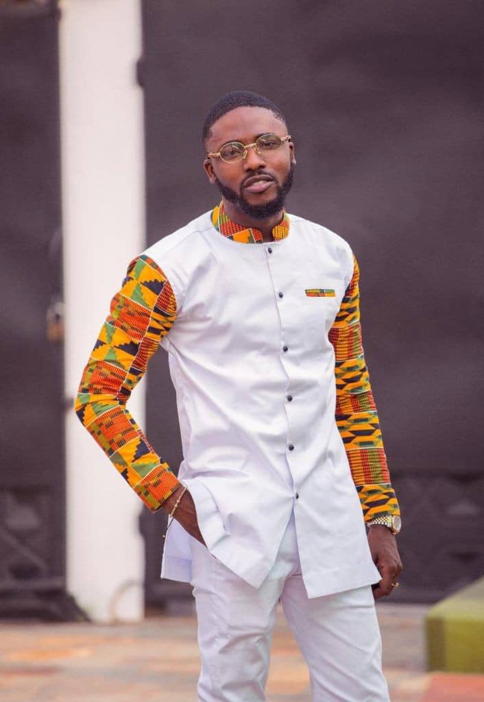 Man wearing mixed kente outfit with white