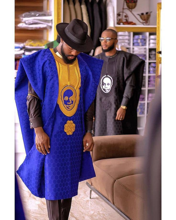 man in a mix and match/embroidered agbada outfit