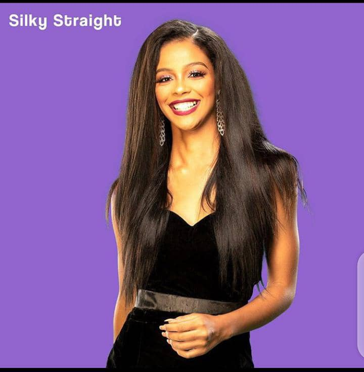 smiling lady in a Darling silky straight weaves
