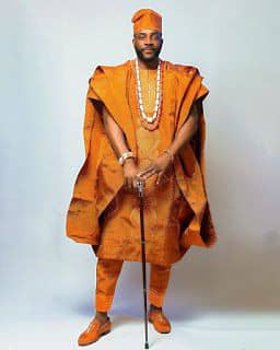 Ebuka rocking an orange agbada