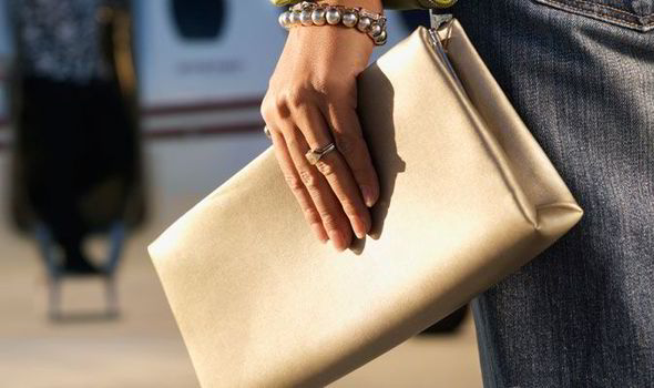 woman carrying a clutch bag