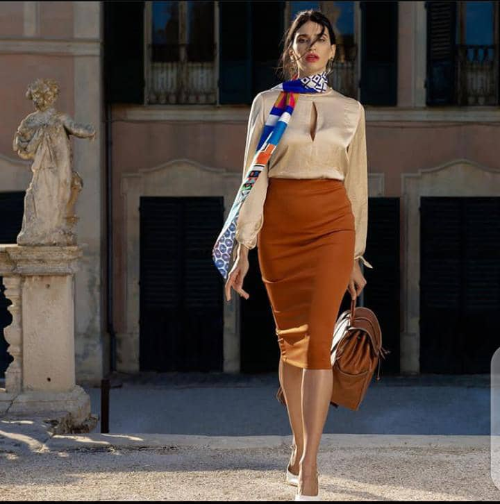 lady wearing scarf and walking