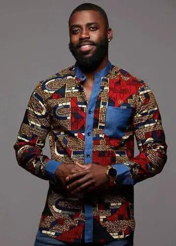 smiling man in a mix and match ankara long sleeves shirt