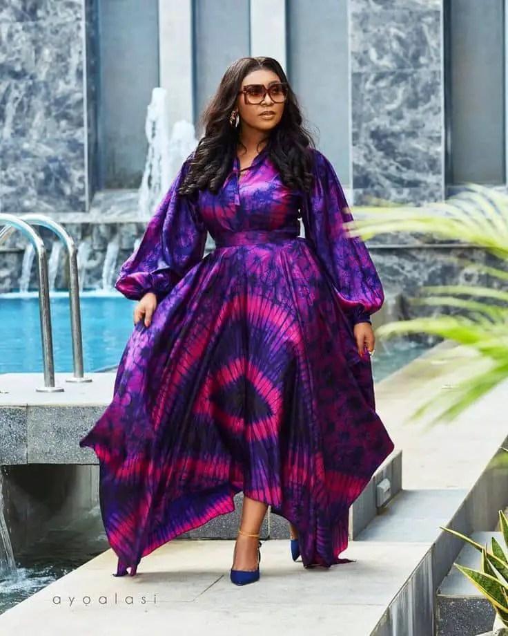 woman wearing flowing long adire pattern dress