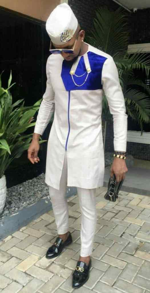 man wearing white and blue mixed senator