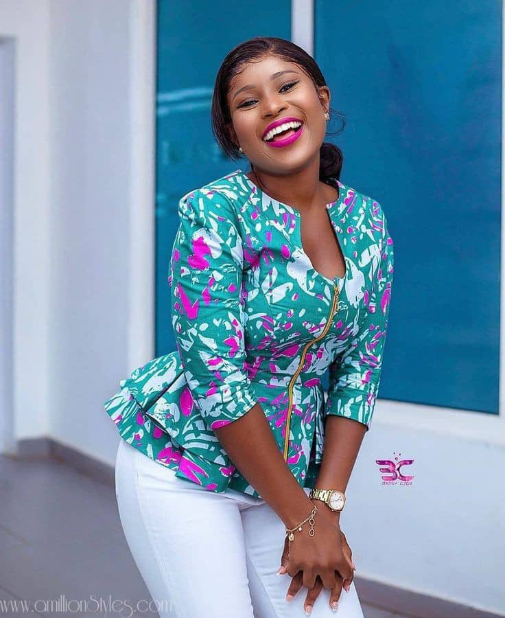 smiling lady wearing peplum ankara top