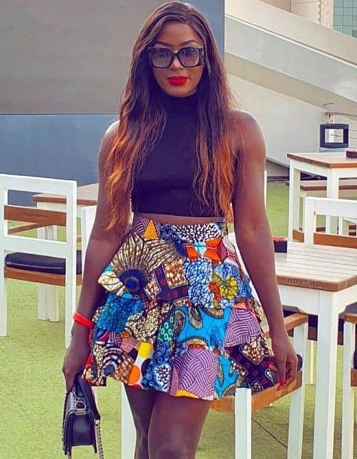 lady wearing ankara short skirt