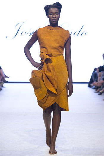 model wearing a dress made from barkcloth on the runway
