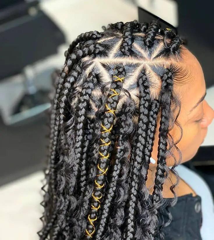 lady wearing box braids Christmas hair