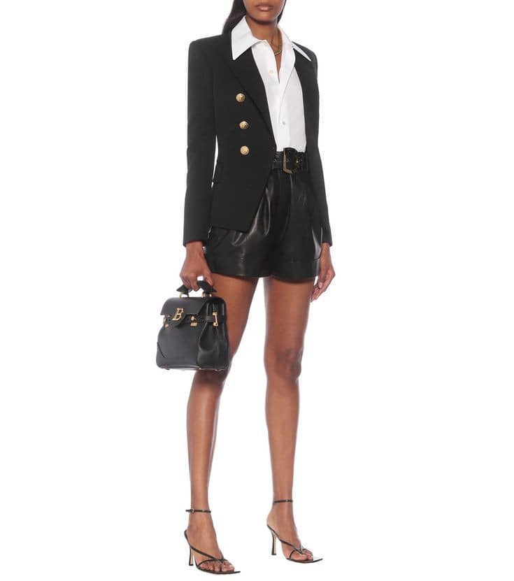 lady appearing casual formal in a black high-waisted shorts and black blazer
