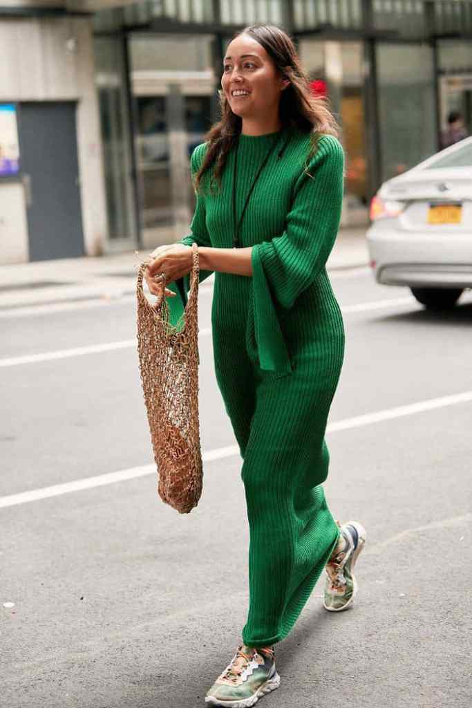 lady in a green maxi dress with sneakers