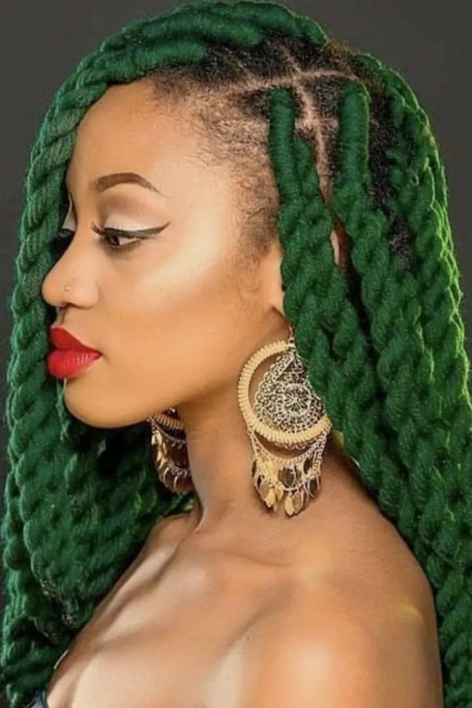 Lady rocking green yarn braids for Christmas