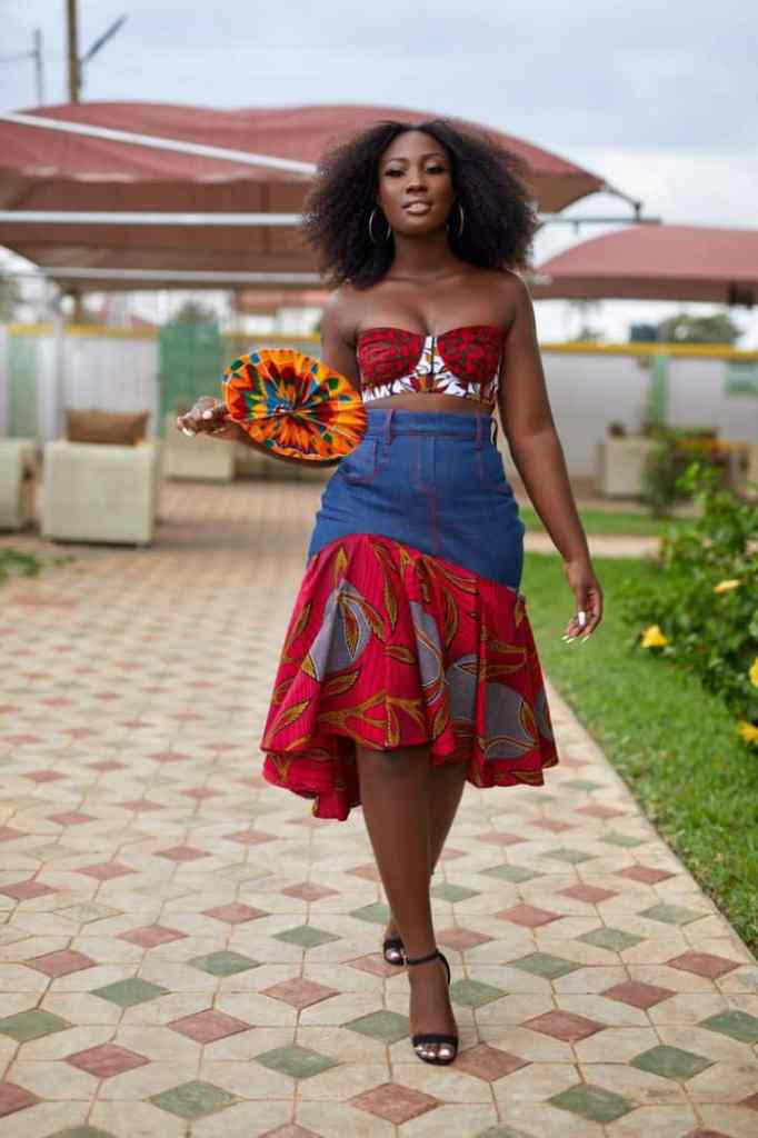 lady wearing jeans skirt mixed with ankara