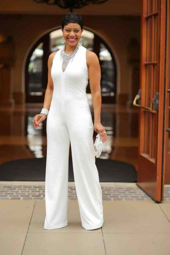 beautiful lady in a plain white jumpsuit