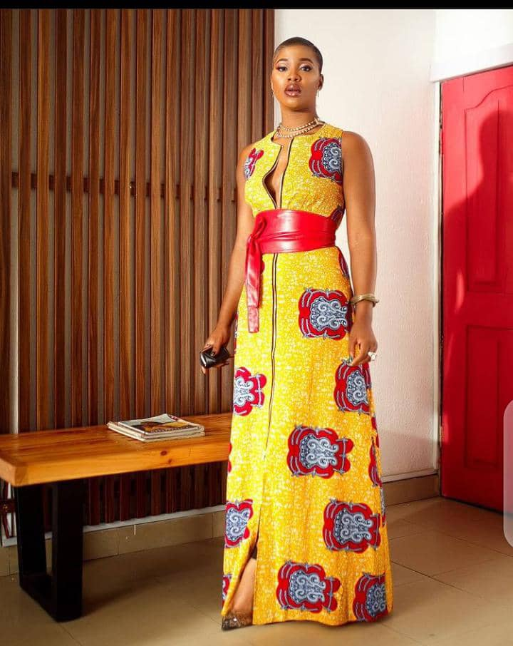 lady rocking a red belt over ankara long gown