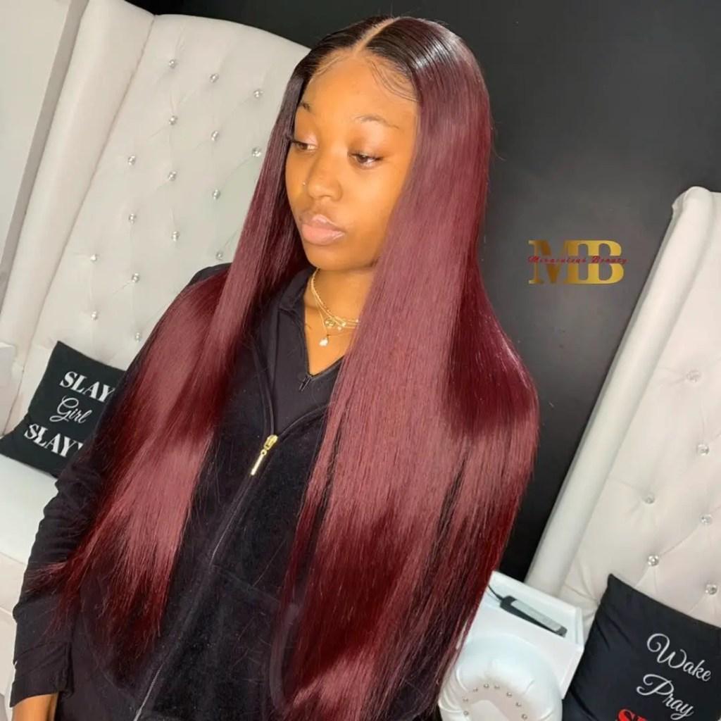 lady wearing red bone straight hair