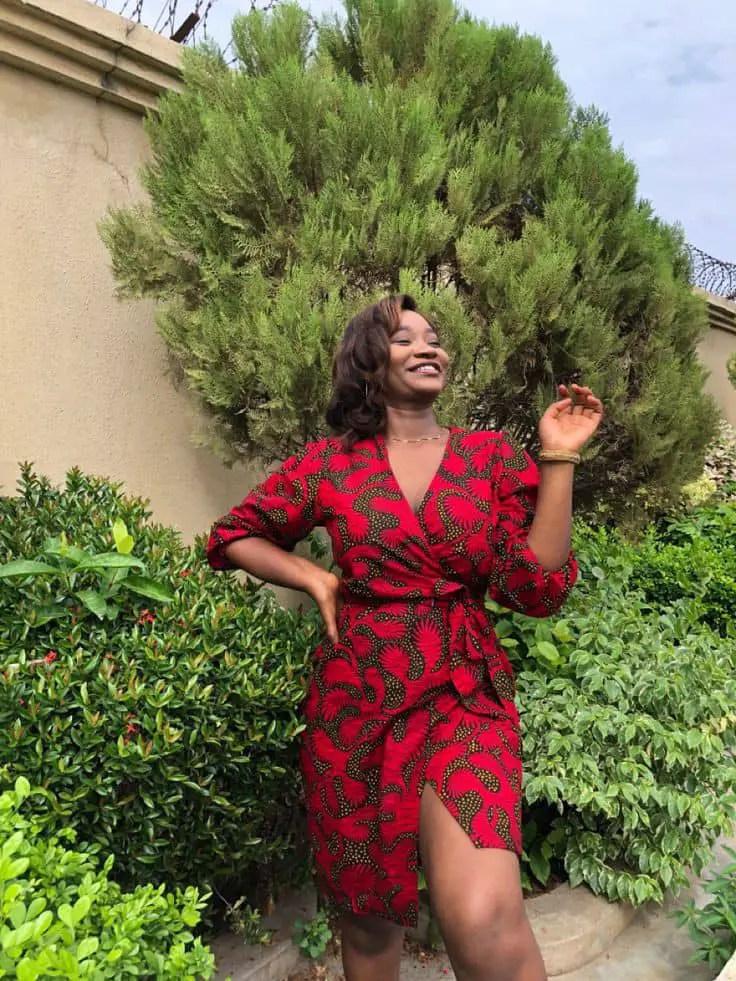 lady wearing a short red ankara wrap dress