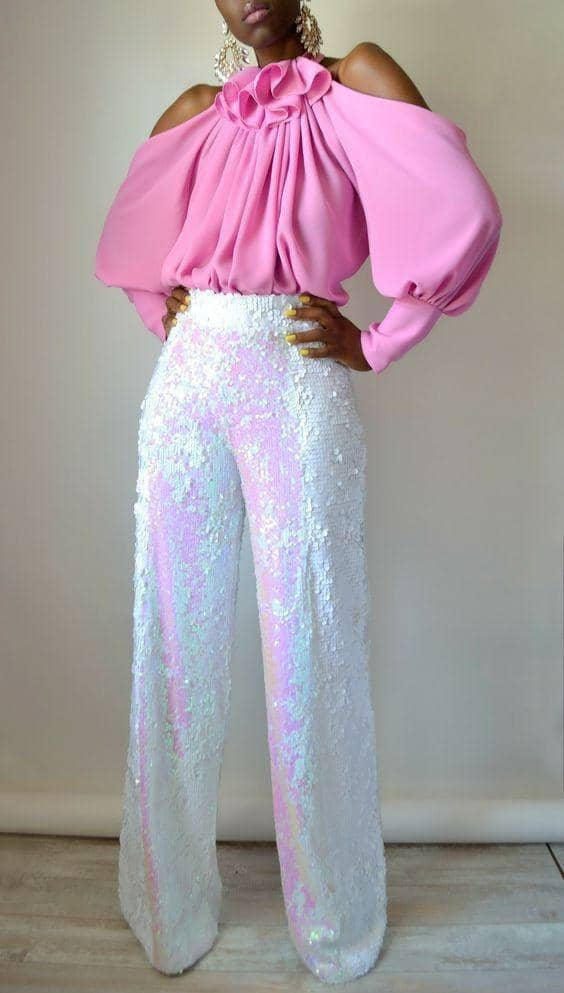 lady in pink top and white palazzo