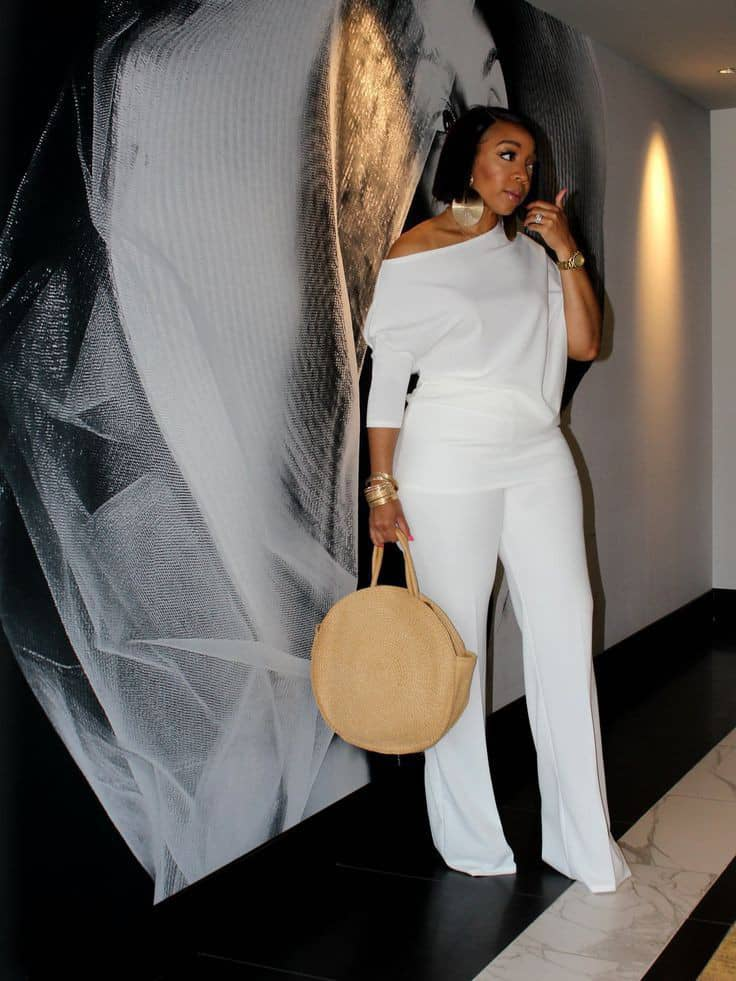 lady wearing white top and flare pants