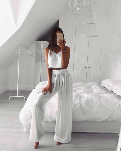 lady rocking white top and palazzo