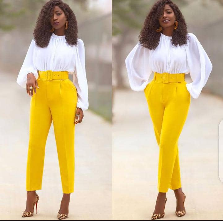 lady rocking white top and yellow palazzo for an office party