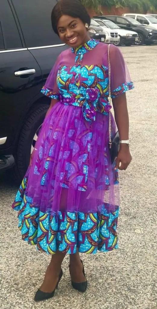 lady in ankara and purple net dress