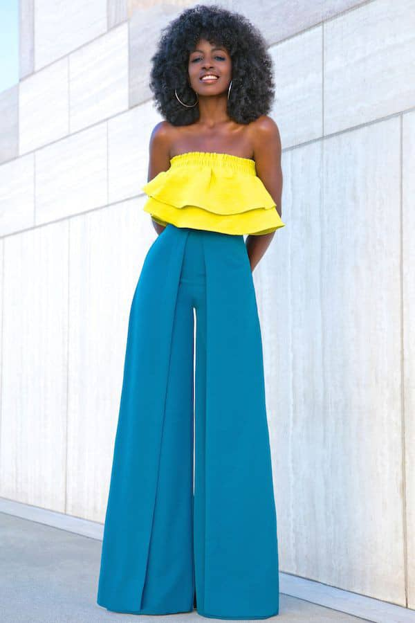 smiling African lady wearing yellow top and green palazzo