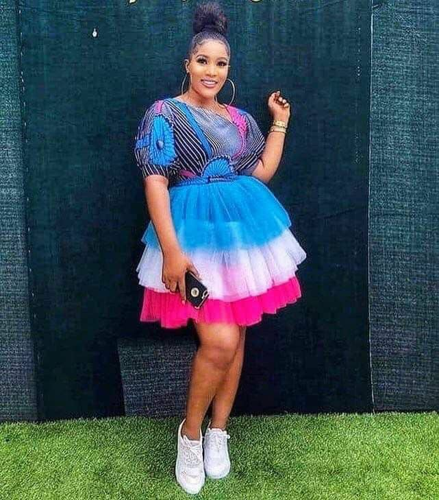 lady wearing ankara and multi color tulle net short gown